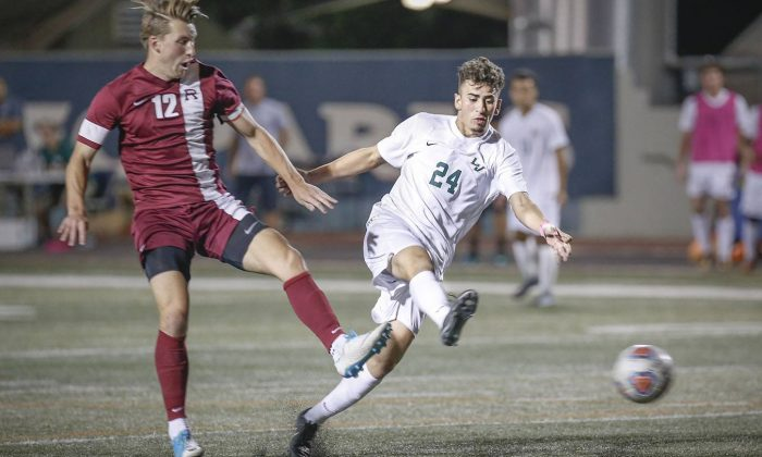 Leopard freshman forward Johnny DeRueda moves the ball downfield after Redlands scored twice in the second half and put an end to La Verne's 2-0 lead Saturday at Ortmayer Stadium. The game remained tied at 2-2 after overtime. / photo by Breanna Ulsh