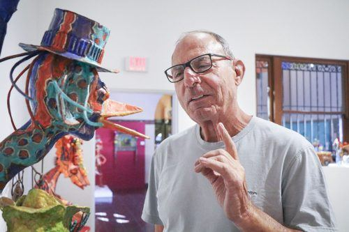 "Albert Marino, 75, of Duarte said the papier mache sculpture, ""Vender,"" created by Dee Marcellus Cole, reminds him of the nose of his best friend from Philadelphia. Marino and his wife, Nancy, visited the exhibit at the Claremont Museum of Art on Sunday. Cole has taught art at the University of La Verne and Chaffey College and was awarded Artist of the Year at the Chaffey Community Museum of Art in Ontario. ""Carnival Seekers"" exhibit is on display through Nov. 26. The Museum on First Street is open from 12 p.m. to 4 p.m. Fri. through Sun. / photo by Katie Pyne"