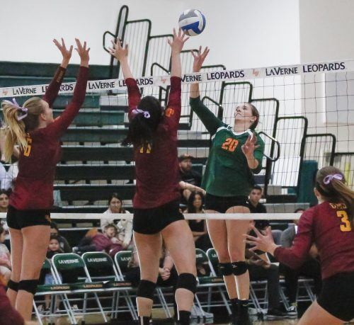Junior middle-blocker Kelsie Sievers tips the ball during the fourth set of the game against the Claremont-Mudd-Scripps Tuesday at Frantz Athletic Court. The Leopards ultimately lost to the Athenas, 3-2, after five sets. La Verne will next face Chapman on the road. / photo by Celeste Drake