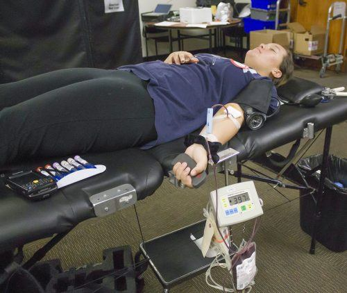 Taylor Garcia, freshman criminology major, gives blood at the Presidents Dining Room Nov. 1. The blood drive is managed by the Red Cross, which will return for future blood drives at the University of La Verne on Jan. 10, March 7 and May. / photo by Celeste Drake