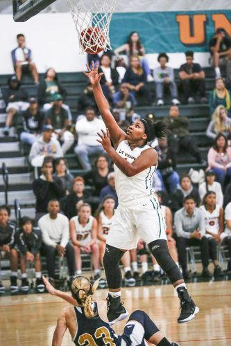 La Verne senior center Kayla Chism drives to the basket in the third quarter Sunday against UC Merced. She missed the layup but drew a blocking foul. Despite a close game through the first three quarters, La Verne fell to UC Merced at Frantz Athletic Court, 92-67. / photo by Breanna Ulsh