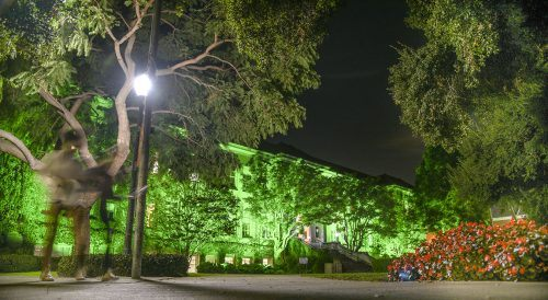 """Founders Hall has been bathed in bright green light since Nov. 3 in a display of appreciation for military veterans called """"Greenlight a Vet."""" The building will remain green at night until Sunday. The Greenlight a Vet Campaign is a show of appreciation for the nation's veterans. It is designed to counter the invisibility vets often feel when they return from war. Displaying green lights around Veterans Day is a show of gratitude for those who have served in the military, according to the two-year-old campaign. / photo by Cortney Mace"""