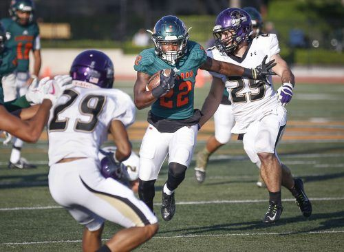 La Verne junior running back Martaveous Holliday gains yardage before being brought down by the Whittier defense in the third quarter Saturday. The Leopards ended the season by taking down the Poets, 82-17, at Ortmayer Stadium. The team ended its season with an overall record of 3-5 and 2-4 in the Southern California Intercollegiate Athletic Conference./ photo by Breanna Ulsh