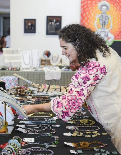 "Esther Garcia of Pomona hand makes and sells her original jewelry, made from beads and leather. Mercado Artisano and Sopa was held Saturday at the dA Center for the Arts in coordination with ""Shop Small."" Small business owners sold handmade pottery, jewelry, clothing and food. / photo by Dorothy Gartsman"