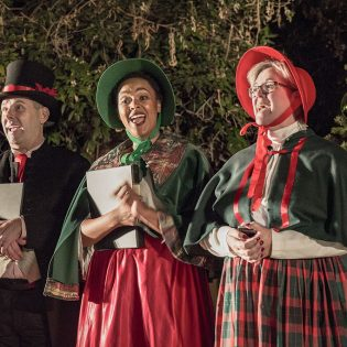 Above: Ken Martinez, Jocyline Mixson Donna Marie Minano of the Inland Valley Repertoy Theatre sing Christmas carols Saturday in Minero Square before the Old Town La Verne Annual Holiday Stroll. Following the Stroll, La Verne Mayor Don Kendrick lit the city Christmas tree. The event, sponsored by local shops and restaurants, also featured pictures with Santa. / photo by Taylor Griffith