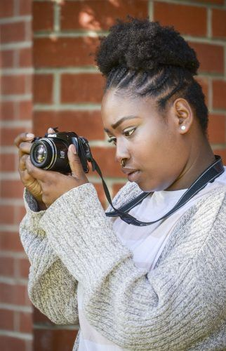 Jedaun Carter, senior psychology major, is the face behind the photography brand CreatiVisionarieZ. Carter, who has always been interested in photography, only recently became a photographer to highlight the beauty of women of color. As a psychology major, Carter said she believes that she understands her models, their confidence and insecurities and that insight helps her to photograph them. / photo by Audrey Gaudette