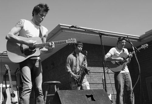 2 Skinny Dorks, a rock band from Cincinnati, Ohio, highlighted Wednesday afternoon's Club Fair in the Quad. 2 Skinny Dorks features Jake Blazer (left) on vocals and guitar, Matt Corey on saxophone and Eric Penrod on guitar. The University of La Verne's annual Club Fair showcased booths from on-campus clubs and organizations. The entertainment was sponsored by the Associated Student Federation Forum and the Campus Activities Board. / photo by Chrissy Zehrbach