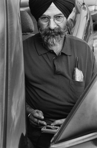 """With the goal of fixing the cars and pleasing every customer, Jaskanwarbar Singh Randhawa said: """"I don't care for money."""" Randhawa has been operating the Performance Auto Center, an auto repair shop, at E Street and Arrow Highway in La Verne, since 1992. His philosophy, he said, is to work according to his family morals and religion. / photo by Yelena Ovcharenko"""