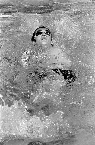 """Freshman Matt Nasont swam the men's 100-yard backstroke event during the Claremont Mudd Scripps Invitational Saturday. Nasont said, """"Swimming is my sport, and as long as I'm here at ULV, I'll be swimming."""" / photo by Jenna Campbell"""