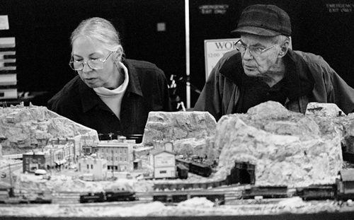 Kyra Compinsky and Warren Hanssler enjoyed their Sunday afternoon admiring a model of the Piute Flats Branch of the Denver and Rio Grande Western Railroad, created by David and Charlotte Hauver. The Great American Train Show, held at the Fairplex in Pomona, provided visitors access to vendors and working model train layouts. / photo by Veronica Garcia