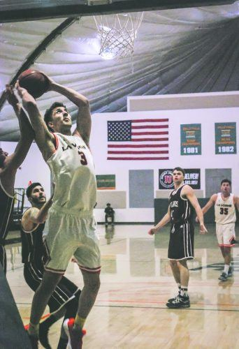 La Verne forward Brandon Rice attempts a shot against the Redlands Bulldogs in the second half at Frantz Athletic Court Feb. 7. The Bulldogs beat the Leopards, 79-73.
