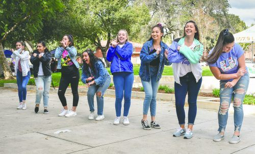 """The ULV dance team performs to a remix of """"It's Tricky"""" and the theme song from the """"Fresh Prince of Bel-Air"""" Monday for students at the 1990s themed club fair in Sneaky Park. The dancers include, from left, Silvia Gonzalez, freshman biology major; Adrianna Verduzco, freshman psychology and political science major; Jacqueline Sánchez, sophomore English major; Florencia Schinoff, junior broadcast major; Alexandra Torres, freshman theater major; Ivonne Damitio, senior legal studies major; and Gabriela Palafox, freshman sociology major. The club fair allowed students to learn about more than 50 clubs and get involved on campus. / photo by Maydeen Merino"""