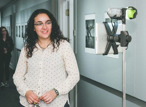 "Senior journalism major Nadira Fatah talks to Canadian photographer Wes Bell via webcam Feb. 15 at ""Snag: Impermanence on the Vast Alberta Prairie"" at the Carlson Gallery. The show exhibits Bell's photographs of plastic bags caught on the barbed wire fences that line a highway in Alberta, Canada. Bell conceived the project after driving home from visiting his mother, who was dying of cancer. He saw the snagged plastic as a metaphor for the impermanence of life. ""Snag"" will remain in the Carlson Gallery until March 16. / photo by Spencer Croce"
