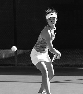 Junior Michelle Tang of the women's tennis team defeated Jenn Knight from Waynesburg College in a singles match, 6-3, 6-2, March 11. Tang, along with her doubles partner Michelle Fontanez, defeated Waynesburg, 8-6. The Leopards shut out the Yellow Jackets, 9-0. / photo by Jenna Campbell