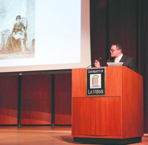 """Kenneth B. Morris Jr., founder and president of the Fredrick Douglass Family Initiatives, speaks at the 2018 Fredrick Douglass Human Rights Lecture Monday. Morris is a direct descendant of Douglass and Booker T. Washington. Using Douglass' life as an example, Morris emphasized the importance of education and how it made Douglass """"unfit to be a slave."""" The Frederick Douglass Family Initiatives seeks to end human trafficking through education and awareness. They donated five books to students for every book sold at the lecture./ photo by Spencer Croce"""