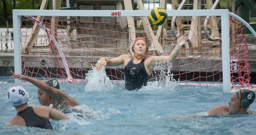 La Verne sophomore goalkeeper Shelby Garcia rises up to block a shot by Cal State East Bay freshman driver Maci Taylor during the first quarter March 22 at the La Verne Aquatic Center. The ball bounced off the crossbar. The Leopards fought hard but fell, 14-6.