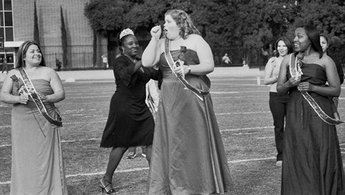 Erin McAndrew (center), nominated to Homecoming Court by Iota Delta Sorority was shocked as Shamira Dejurnett, last year's Homecoming Queen, handed over the crown. Andi Nunez and Ebonie Lofton stood by to congratulate McAndrew. / photo by Amy Babin