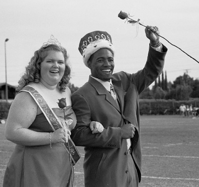 Erin McAndrew and Jason Walker were crowned the 2003 Homecoming Queen and King at Saturday's game. Walker was confident holding an emotional McAndrew by his side. / photo by Amy Babin