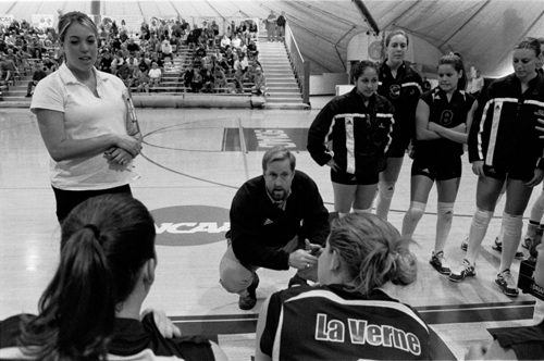 Don Flora advises the University of La Verne women's volleyball team during a timeout Saturday against Emory University. The team lost the semifinal game to Washington (Mo.) Friday, moving on to play Emory for a third-place finish in the NCAA Championship tournament, coming away victorious, 3-0. / photo by Adam Omernik