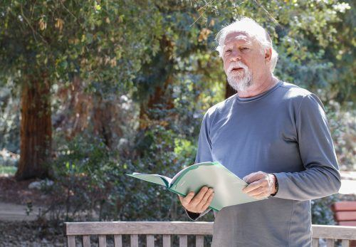 """William Galasso reads a haiku about war heroes and people who have played significant roles in his life at the Rancho Santa Ana Botanic Garden's """"A Garden of Verses"""" event Saturday. The event invited California poets and visitors to support National Poetry Month. Galasso has been writing poetry for 50 years and haiku for 30. He has published 15 books. / photo by Katie Pyne"""