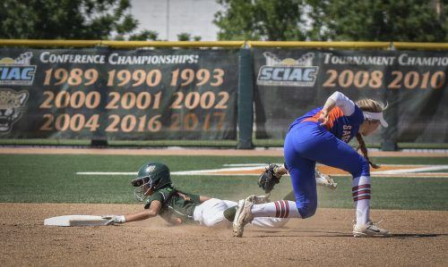 La Verne junior left fielder Rachel Ogata steals second base under the tag of Pomona-Pitzer sophomore shortstop Izzy Deatherage in the second inning of the first game of Saturday's doubleheader at Campus West. The Leopards won the first game, 3-2, but fell short in the second game, 7-5. / photo by Maydeen Merino