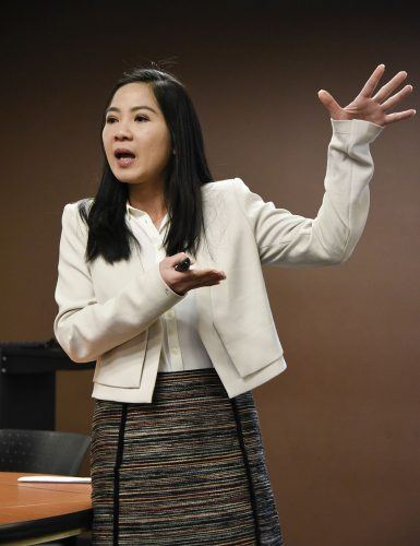 """An Tran, assistant professor of marketing, explains consumer budgeting in her lecture, """"Consequences of Broad or Narrow Product Categories on Budgeting,"""" during her faculty lecture Tuesday in the President's Dining Room. Tran studies consumer behavior, economics and psychology, and has been published in the Journal of Marketing Research./ photo by Claudia Ceja"""