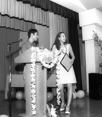 """Latino Student Forum President Erick Vasquez presented Sonia Nuñez with the Member of the Year Award at the annual Bienvenida Dinner. Nuñez received the award because of her dedication and loyalty to the club, Vazquez said. The dinner, held Sunday at the La Verne Community Center, also honored Cidieco """"Cid"""" Pinero with the Community Service Award. / photo by Jennifer Contreras"""