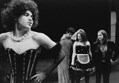 "At rehearsals for ""The Rocky Horror Show,"" Dr. Frank-N-Furter (Jonathan Serret), Riff Raff (Anthony Guerrero) Magenta (Brianna Roth) and Columbia (Whitney Wickum) show off their costumes, which were designed by Ted Shell, a costume designer credited with developing costumes for many celebrities, including Elvis Costello, Steven Spielberg and Michael Jackson. Many of Shell's racy costumes will be perfected by the time the show premieres, Oct. 30. / photo by Adam Omernik"