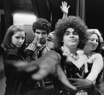 Magenta (Brianna Roth), Riff Raff (Anthony Guerrero), Frank N Furter (Jonathan Serret) and Columbia (Whitney Wickham) appear in The Rocky Horror Picture Show opening on Oct. 30. Participation in the production is encouraged for audience members. They are invited to wear costumes, shout catch phrases at the characters when appropriate and bring props (or use those provided for a fee) to throw on stage. / photo by Adam Omernik