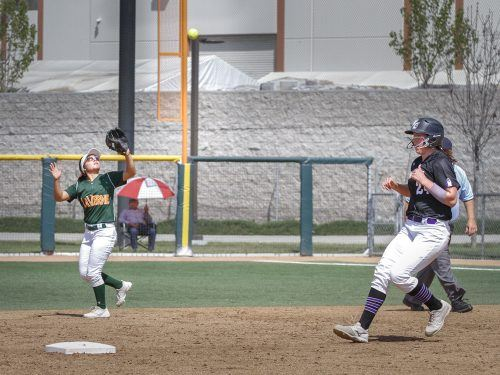 La Verne freshman second baseman Mikayla Mendoza catches the ball behind Whittier junior catcher Brittany Attaway to end the third inning of game one of Friday's doubleheader at Campus West. The Leopards outwitted the Poets to win both games, 4-3, and 2-1.