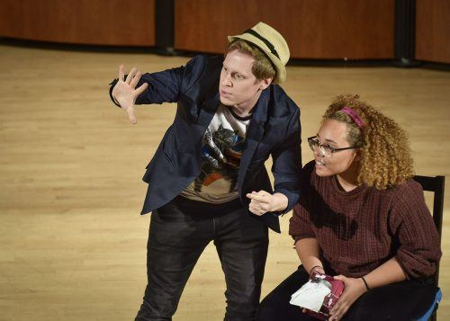 Ben Seidman, a magician and comedian, performs for students Tuesday in Morgan Auditorium. Kiana Maria Gonzalez, freshman political science major, volunteered to be part of the show for a trick in which Seidman made the tissues from the box she was holding disappear. Seidman's shows are known for a combining sleight-of-hand tricks, pickpocketing and comedy. Seidman performs regularly at the Magic Castle in Hollywood and also tours the country performing at colleges, parties and special events./ photo by Sara Flores