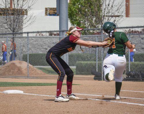 La Verne sophomore first baseman Katheryn Navarro narrowly avoids a tag by Claremont-Mudd-Scripps senior first baseman Briana Halle during the fourth inning of the first SCIAC Postseason Tournament game Friday. The Leopards fell to the Athenas, 2-0.
