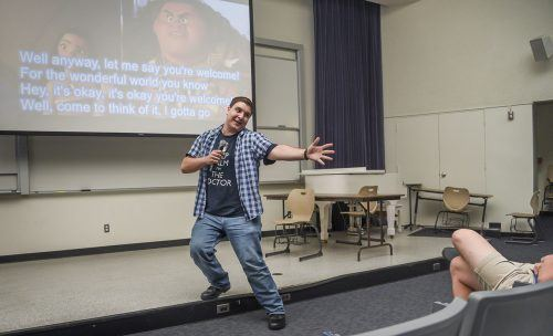 "Junior theater major Joseph Baum gets into character during his dance performance to ""You're Welcome"" from Walt Disney's ""Moana"" at ASULV's Karaoke Night Tuesday in LaFetra Lecture Hall. / photo by Cortney Mace"