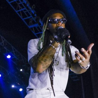 """Singer-songwriter and rapper Ty Dolla $ign headlines the eighth annual LaVernapalooza concert May 10 at the Fox Theater in Pomona. More than 100 La Verne students danced and sang along to """"Paranoid"""" and """"Blasé,"""" among other favorites. Ty Dolla $ign shared the stage with opening special guest Travis Porter to start off the concert. See story on page 9. / photo by Claudia Ceja"""
