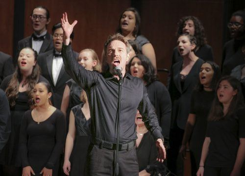 "Ryan Harrison, 1998 University of La Verne alumnus, sings lead in ""I'll Be On My Way"" with the University Chorale for ""Inspire,"" a concert by the Chambers Singers and University Chorale Friday in Morgan Auditorium. / photo by Katie Pyne"