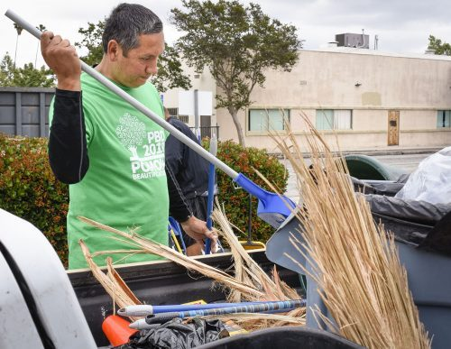 Pomona Mayor Tim Sandoval packs up cleaning supplies in a trash-filled truck at the 12th annual Pomona Beautification Day Saturday. Hundreds of residents and volunteers from the community worked together at 33 project sites from 8 a.m. to noon. Volunteers picked up trash, planted trees, helped start community gardens and created what is soon to be Pomona's first wilderness trail.