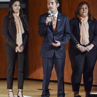 Senior business administration major Jose Perez gives the Enactus team's presentation Tuesday in Morgan Auditorium with junior business administration majors Alyssa Noriega and Seham Musleh. The team, which won in the San Bruno Regional Competition, will head to national competition in Kansas City, Missouri, this weekend in hopes of qualifying for the Enactus World Cup. The team presented on the work they have done in Pomona and abroad. / photo by Sara Flores