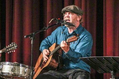 "Danny Oberbeck performs during a concert in Morgan Auditorium Sunday with Michael Ryan and Friends. Oberbeck played several of his original songs, including ""She's Just a Moonshiner's Daughter, But I Love Her Still"" and ""As Far As Far."" Oberbeck began his musical career in 1981 at age 14 with his punk band Lost Cause. / photo by Katie Pyne"