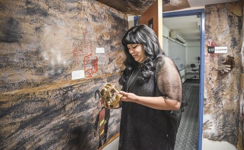 Lamba Alpha Anthropology Honor Society president Billie Guererro and her fellow club members have created a replica of the prehistoric artwork in Argentina's Cueva de los Manos in the Hoover Building. A recent study suggests that the cave art dates back 65,000 years ago. Guerrero said she got the idea for the project after working at the Raymond M. Alf Museum of Paleontology in Claremont. / photo by Cortney Mace