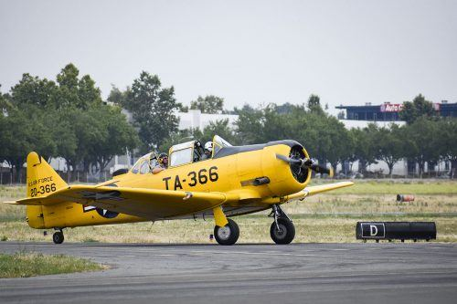 A pair of pilots take a 1952 Harvard MK IV fixed wing single-engine plane for a spin Tuesday at Brackett Field in La Verne. The aircraft, a training plane, can go 205 mph at 5,000 feet. The airport hosts an aircraft and classic car display on the third Sunday of every month. Parts of the event were canceled last Sunday because of inclement weather./ photo by Natasha Brennan