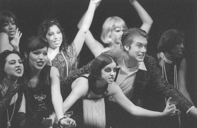 """In a song about being """"very, very wealthy,"""" the cast of """"Brecht-Fest with Weil"""", sang and danced to a full house in the Cabaret, Friday night. The show, which ran from Feb. 4 to 8, combined poetry and prose from Bertolt Brecht and music from Kurt Weil and was presented in """"Cabaret style."""" From left to right are Ayana Moultrie, Brianna Roth, Adrianna Ortega, Sarah Morales, Whitney Wickman, Jonathan Serret, James Darrah and Bjana Washington. / photo by Jennifer Contreras"""