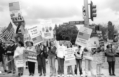 The corner of Arrow Highway and Indian Hill Boulevard was the sight of a war rally, with people from all sides of the issue. April 4, was like any other Friday afternoon where community members carried signs and banners to show either their support for the war or their opposition. Those rallying for the support of U.S. troops in the Middle East say that their demonstrations are in direct response to the anti-war protests that started as early as last fall. / photo by Jennifer Contreras