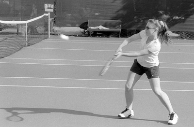 Desiree Whipperman, junior, plants her feet firmly as she follows through on a backhand shot to her Sagehen opponent. The ULV women's tennis team played Pomona-Pitzer on Friday. The Leopards were shutout by the Sagehens, 8-0. / photo by Bailey Porter