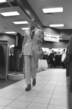 """Senior Jamila Anderson participated as a model in """"Dress for Success,"""" an event showcasing business attire clothing held Monday night at Steinmart on Foothill Boulevard. The fashion show was sponsored by the Associated Students Federation Forum and the Career Development and Placement Center. Steinmart, in collaboration with these ULV organizations, provided the clothing for the models. / photo by Jennifer Contreras"""