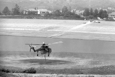 More than two dozen aircraft were used to fight the fire that covered 11 miles of land over La Verne and San Dimas, including the Sikorsky S-64 Skycrane. These helicopters, which have a maximum gross weight of 42,000 pounds., are privately owned but have been licensed to the United States Forest Service. The helicopters used La Verne's Live Oak Reservoir to reload. / photo by Jennifer Contreras
