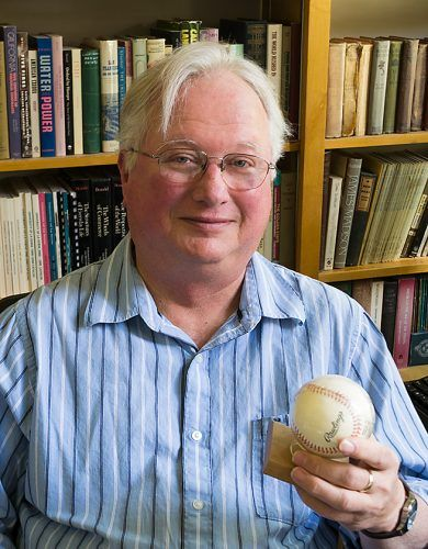 Dr. Stephen Sayles shares one of his favorite mementos, a baseball signed by Negro League ballplayer Buck O'Neil he recieved as a gift from some former students, in a file photo from 2014. Dr. Sayles died Sept. 1 at the age of 73. / file photo by Julian Burrell