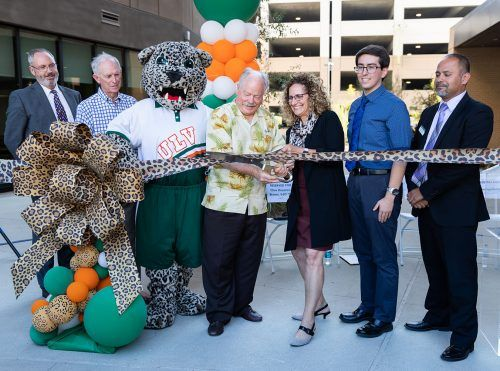 Clive Houston Brown, vice president for facilities, technology, human resources and campus safety; University trustee Robert Dyer; La Verne Mayor Don Kendrick; University President Devorah Lieberman; Residence Hall Association President Race Dibble; and Dean of Students Juan Regalado attend the ribbon cutting during the grand opening of Citrus Hall and The Spot Sept. 6. / photo by Celeste Drake