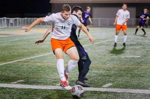Junior midfielder Jack Kolodge fights for control of the ball to score a goal during the last half of the game against Cal Lutheran Wednesday. The Leopards beat the Kingsmen in an overtime win, 2-1. / photo by Katelyn Keeling