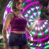 Sophomore psychology major Faith Martinez dances with a rave hoop at the Campus Activity Board's Escape the Pressure event Sept. 13. Students enjoyed churro sundaes, made bracelets and played cup pong and a spin-the-wheel game. At each activity, CAB members engaged students with information about substance abuse.