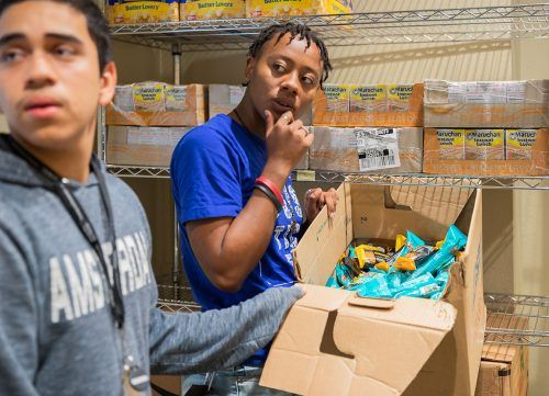 Student workers Mark Ruiz, freshman business administration major, and K'lema Burleson, junior anthropology major, organize boxes of food for the Leo Food Pantry program Sept. 19. The pantry is located in the Vista La Verne Residence Hall. Ruiz says volunteering has always been a part of who he is, so working at the pantry came naturally. He said he hopes the service on campus will help relieve some stress student's face. Students who want to sign up to receive a box can visit laverne.edu/chaplain/student-food-pantry.